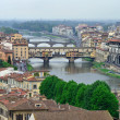 Medieval bridge over the Arno River, in Florence, Italy — Stock Photo #25195427