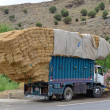 Stock Photo: Overloaded truck staying on road
