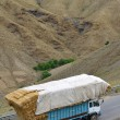 Overloaded truck on road, Morocco — Stock Photo