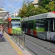 Modern tram in old town street — Stock Photo #30366581