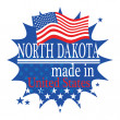 Label with flag and text Made in North Dakota — Imagen vectorial