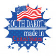 Label with flag and text Made in South Dakota — Stock Vector