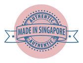 Sello con el texto auténtico, hecho en singapur — Vector de stock