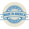 Grunge rubber stamp with the text Authentic, Made in America — Векторная иллюстрация