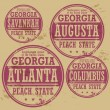 Grunge rubber stamp set with names of Georgia cities — Stock Vector