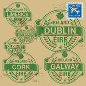 Grunge rubber stamp set with names of Ireland cities — Stock Vector