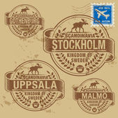 Grunge rubber stamp set with names of Sweden cities — Wektor stockowy