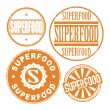 Grunge rubber stamp set with the text Super food — Stock Vector