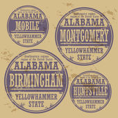 Grunge rubber stamp set with names of Alabama cities — Stock Vector