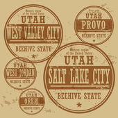 Grunge rubber stamp set with names of Utah cities — Stock Vector