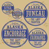 Grunge rubber stamp set with names of Alaska cities — Stock Vector