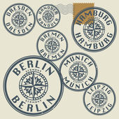 Grunge rubber stamp set with names of Germany cities — Stock Vector
