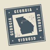 Grunge rubber stamp with name and map of Georgia, USA — Stock Vector