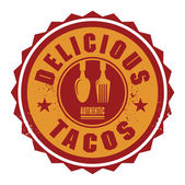 Abstract stamp or label with the text Delicious Tacos — Stock Vector