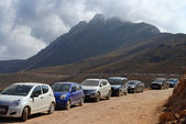 Car parking on mountain gravel road — Stock Photo