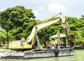 Floating excavator — Stock Photo