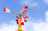 Red and white windmill — Stock Photo
