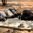 Muslims praying in congregation outside, islamic Prayer - Stockfoto