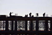 Silhouette of working and building construction — Stock Photo