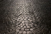 Light is reflected back cobblestone — Stock Photo