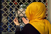 Islamic old gravestone in a cemetery and women — Stock Photo