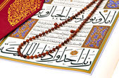 Muslim rosary beads on the Holy Quran — Stock Photo
