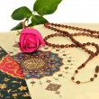 Stock Photo: Muslim rosary beads on Holy Quran