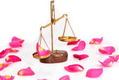 Rose scales of justice over white background — Stock Photo
