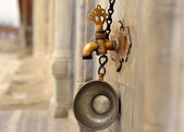 Date of ablution tap made of brass — Stock Photo