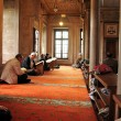 Постер, плакат: Muslim men reading the Holy Quran
