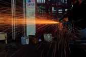Chopping metal worker in the factory — Stock Photo