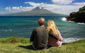 Young couple observe Volcano Mount Pico from the coast of Faial, Azores — Stock Photo