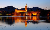 The old romanic bridge of Ponte de Lima after sunset — 图库照片