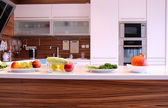Fruit and vegetables in the well designed modern kitchen — Stock Photo