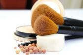 Makeup foundation, powder, bronzer and brushes — Stock Photo