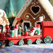 Royalty-Free Stock Photo: Christmas baked sweet houses and red train