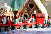 Christmas baked sweet houses and red train — Stock Photo