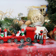 Christmas decorations and toy red train — Stock Photo