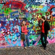 John Lennon wall in Prague and young beautiful couple in love — Stock Photo #13815853