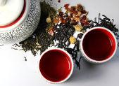 Teapot and mix of tea — Stock Photo