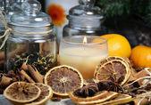 Candle, cinnamon sticks and dry orange — Stock Photo