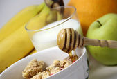 Muesli with honey and fruits — Stock Photo