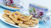 Tea time with cookies — Stock Photo