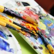 Art palette and paintbrushes — Stock Photo