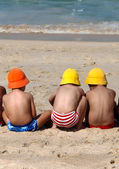 Three cute small children playing on the beach — Stock Photo