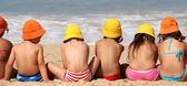 Cute funny children on the beach — Stock Photo