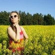 Foto Stock: Young beautiful funny womand yellow fields