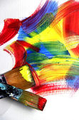 Vivid strokes and paintbrushes — Stock Photo