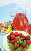 Fresh juicy strawberry and gooseberry — Stock Photo