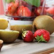 Fresh fruits in the blender — Stock Photo #26533087